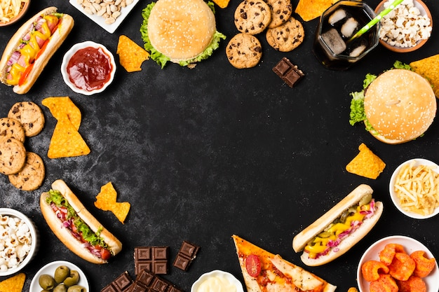 Junk food on black slate with copy space