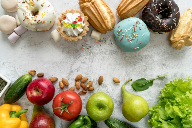 Junk food and healthy food on old concrete background