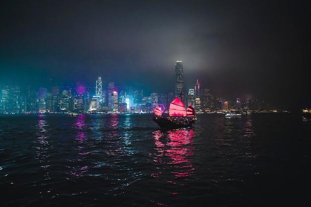 Junk ship sailing in a victoria harbor, hong kong