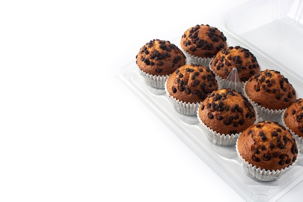 Just baked chocolate muffins packaged isolated on white background
