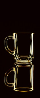 Just a glass on a black background with a reflection. yellow colors. isolated.