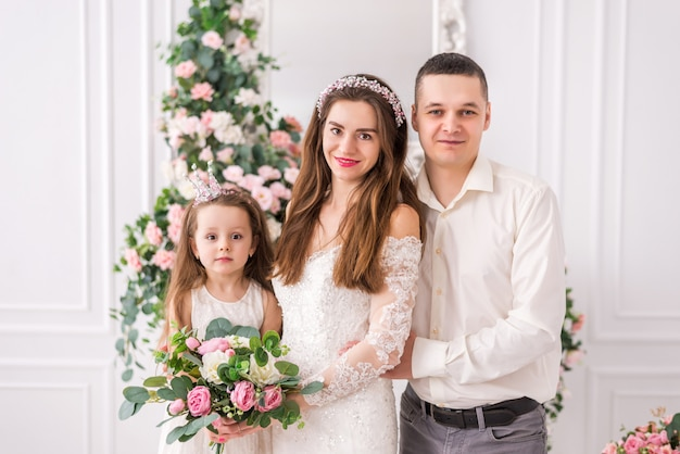 Just married couple with her daughter