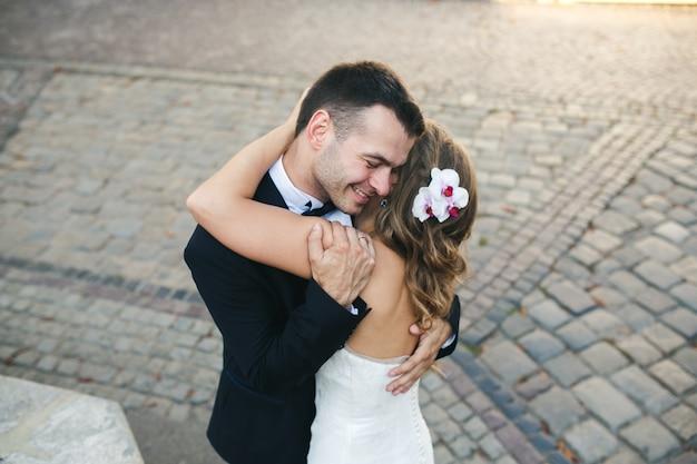 Just married hugging