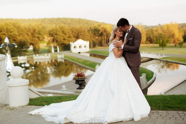 Just married loving couple in wedding dress and suit