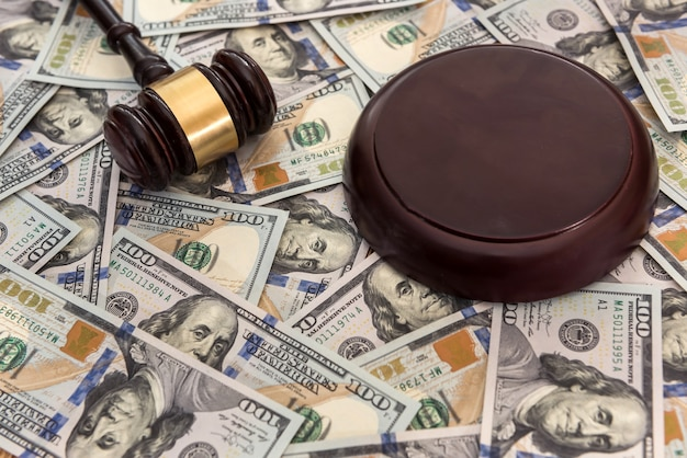 Justice gavel on dollar banknotes. legal concept
