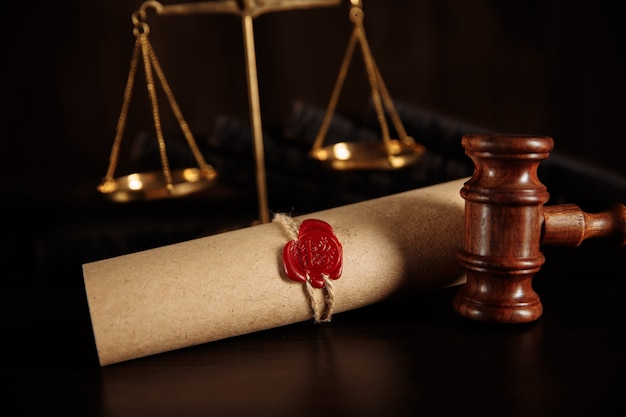 Justice gavel and last will and testament document on wooden table