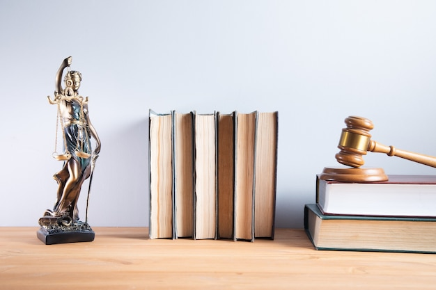 Justice lady with judge on law books
