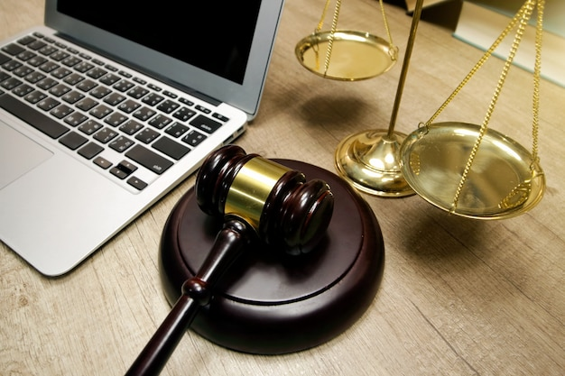 Justice and law concept. lawyer workplace with laptop on the table