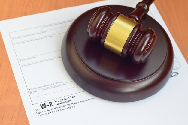 Justice mallet and w-2 wage and tax statement form from irs