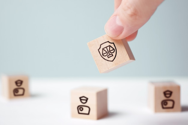 Justice and police interaction concept on abstract wooden blocks.