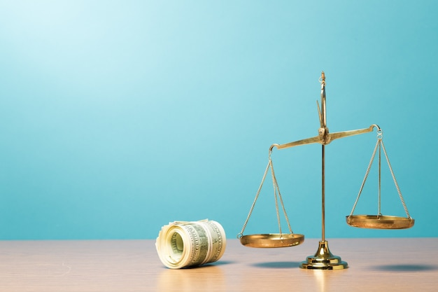Justice scales with money on table. justice concept