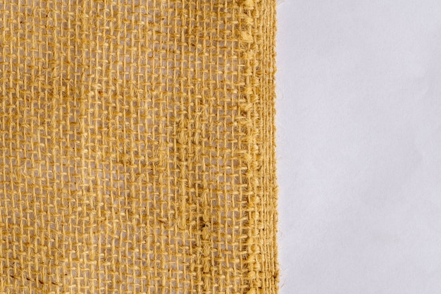 Jute fabric texture on white background.