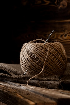 Jute skein on an old wooden wall