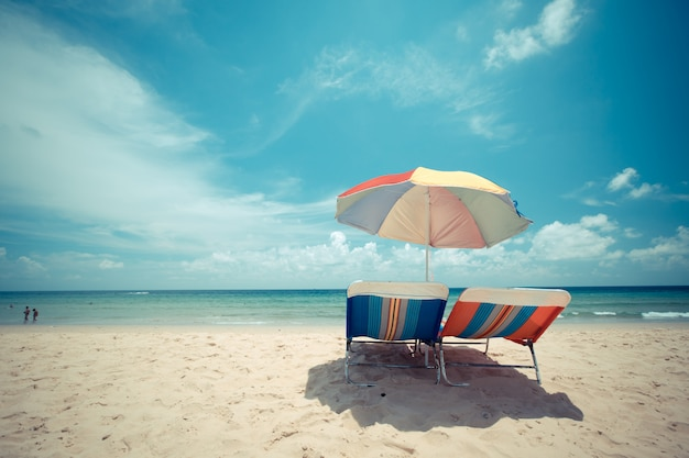 Ka-ron beach at phuket , thailand. sand beach with beach umbrella. summer, travel, vacation and holiday concept.