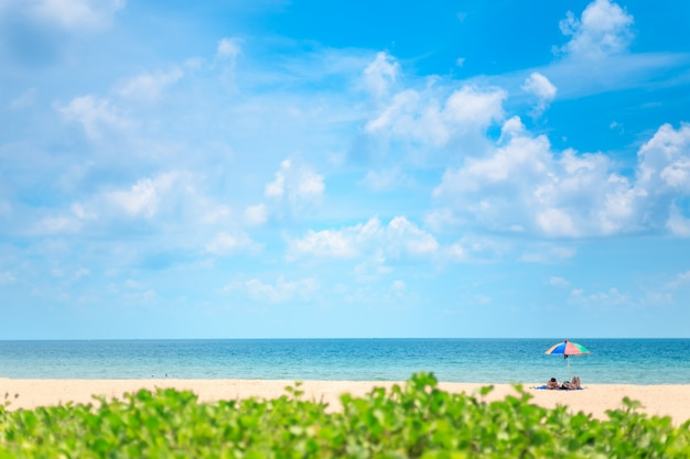 Ka-ron beach at phuket , thailand. sand beach with beach umbrella. summer, travel, vacation and holiday concept.