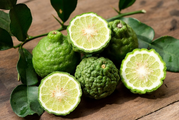 Kaffir lime or leech lime fruits  on an old wood .