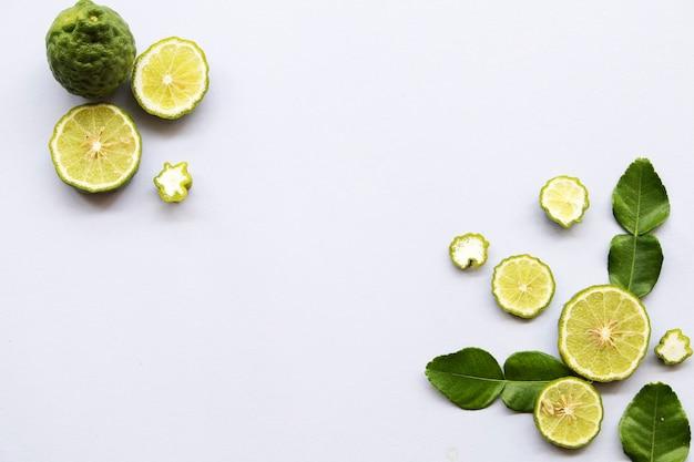 Kaffir lime local vegetable arrangement on white