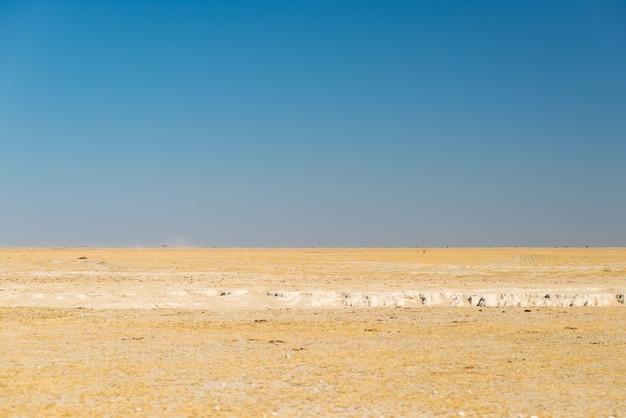 Kalahari desert, salt flat, no where, empty plain, clear sky, botswana