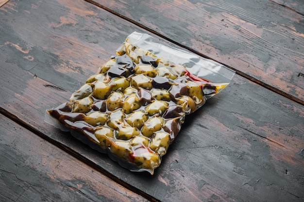 Kalamata olives with herbs, on old wooden table