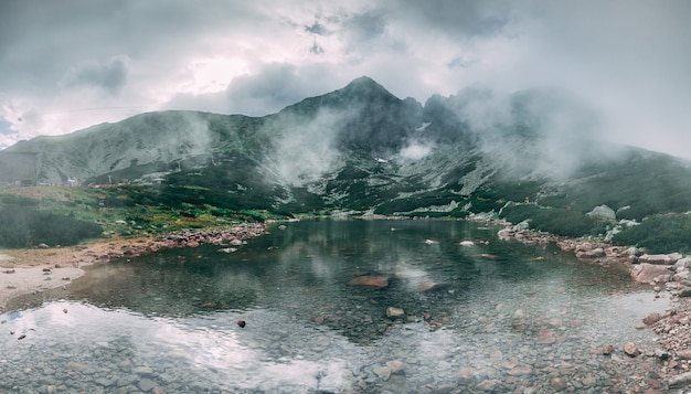 Kalnate pleso lake surrounded by thetatras.