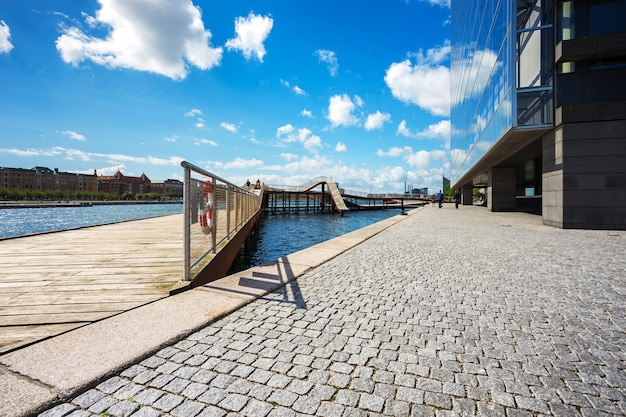 Kalvebod bridge park near river and modern office in copenhagen, denmark, scandinavia