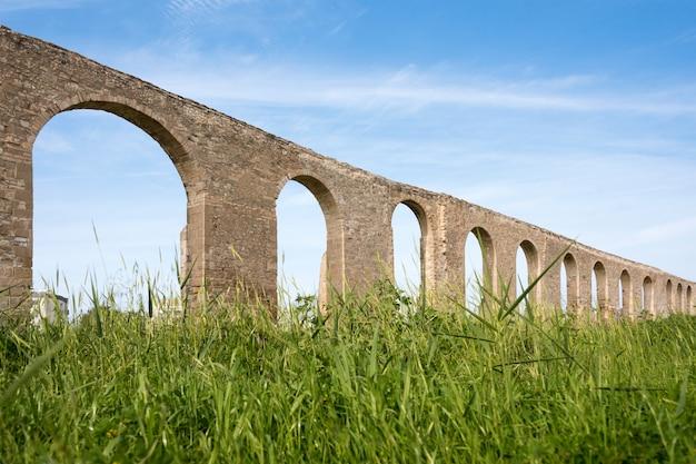 Kamares antique aqueduct in larnaca, cyprus. ancient roman aqueduct