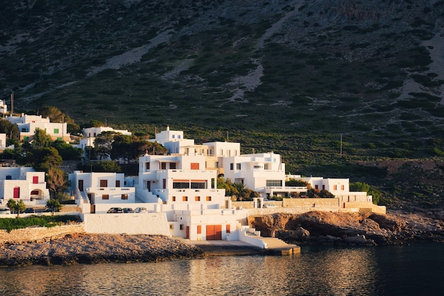 Kamares town with traditional white houses on sifnos island on sunset greece