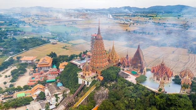 Kanchanaburi thailand with smoke from burning rice stubble on background