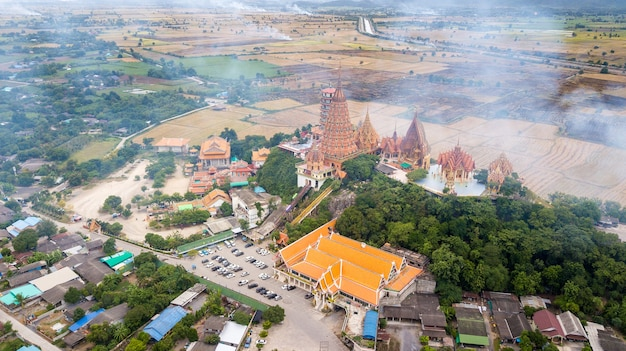 Kanchanaburi thailand with smoke from burning rice stubble on background
