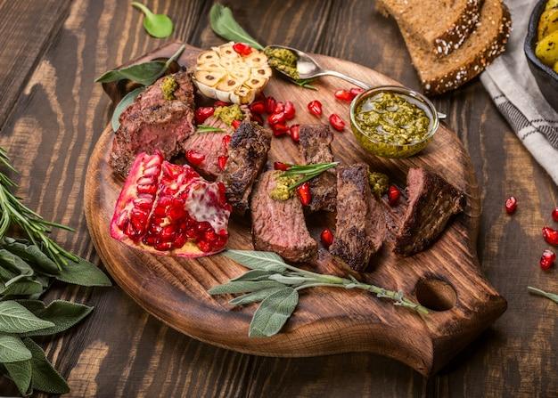 Kangaroo meat steak with green pesto and pomegranate