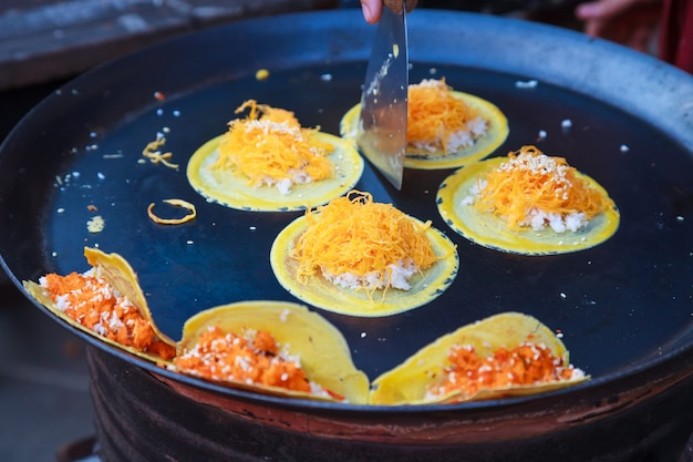 Kanom buang, thai crispy pancake crepe with salty minced shrimp filling on fry pan
