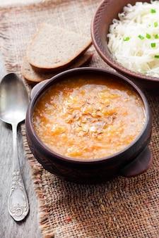 Kapustnyak - traditional ukrainian winter soup with sauerkraut, millet and meat