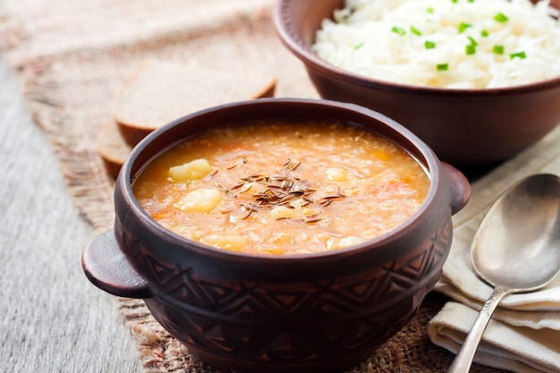 Kapustnyak - traditional ukrainian winter soup with sauerkraut and millet