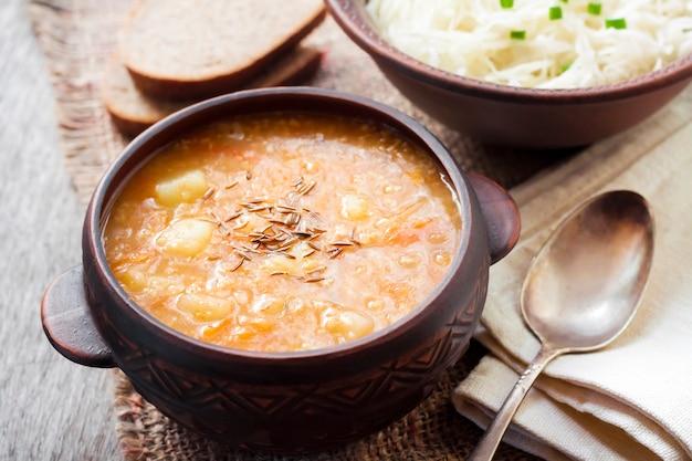 Kapustnyak, traditional ukrainian winter soup with sauerkraut and millet