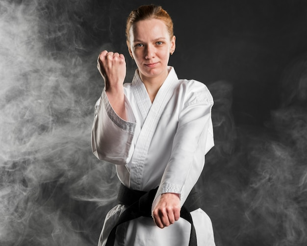 Karate fighter posing medium shot