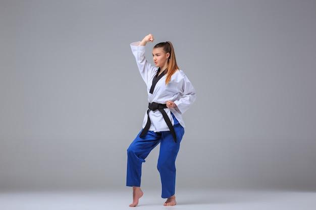 Karate girl with black belt