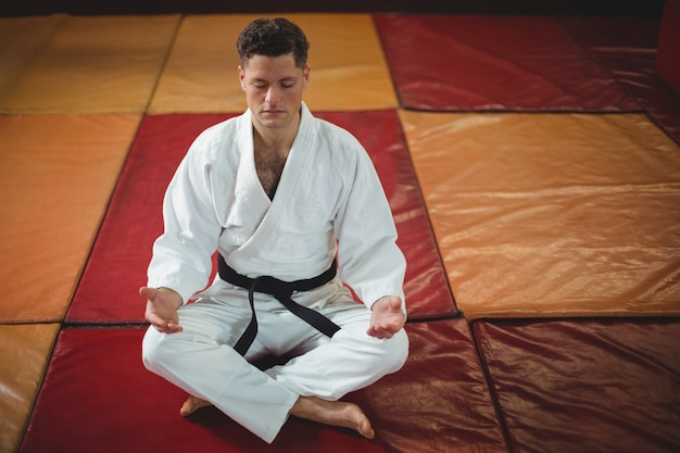 Karate player doing yoga