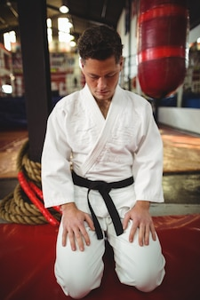 Karate player sitting in seiza position