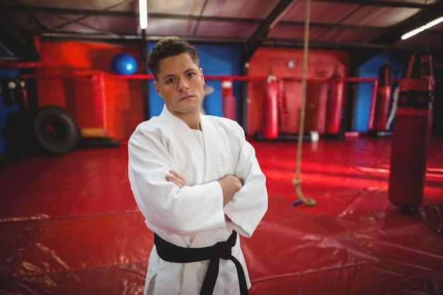Karate player standing in fitness club