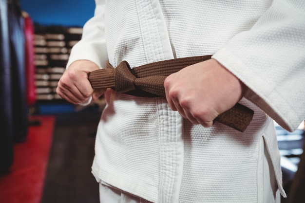 Karate player tying his belt