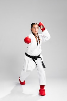 Karate woman in action isolated in white background