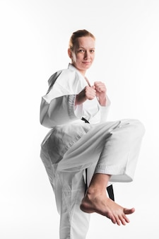 Karate woman kicking front view