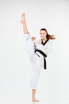 The karate woman with black belt
