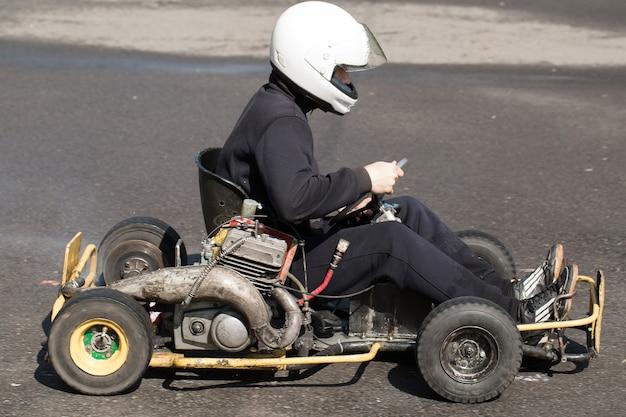 Karting - driver in helmet on kart circuit Premium Photo