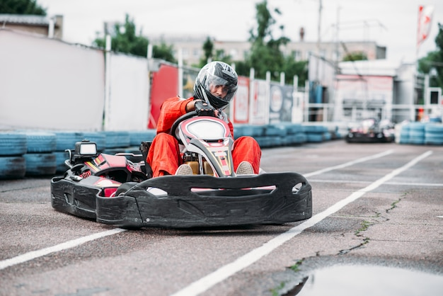 Karting racer in action, go kart competition on outdoor track. carting championship