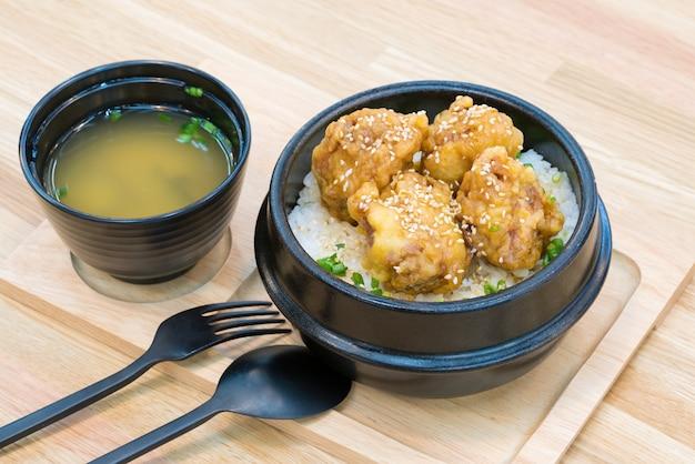 Katsudon - japanese breaded deep fried pork cutlet on wooden table.