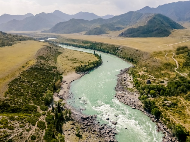 Katun river with turquoise waterbeautiful landscape mountains and hills altai mountains russia