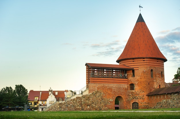 Kaunas castle in the gothic style in summer at sunset, lithuania.
