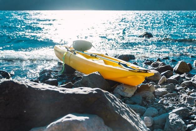 Kayak in lake on stones