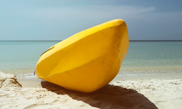 Kayak on tropical beach ao phrao on the samet island in thailand. vintage conception.